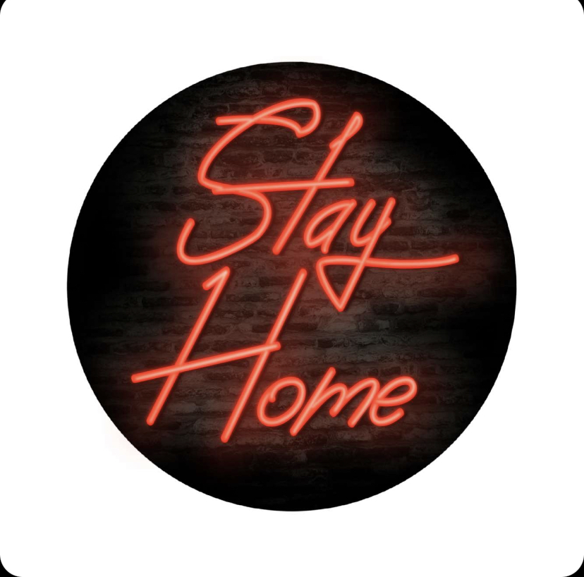 Neon sign with the words Stay Home with a dark brink background