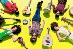 Lemon yellow background with people laying alternativing and instruments everywhere