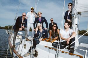 The Nashville Yacht Club band members on sailboat
